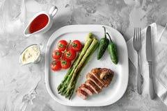 Sliced steak on white plate served stock images
