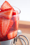 Sliced strawberries in a cocktail glass Royalty Free Stock Image