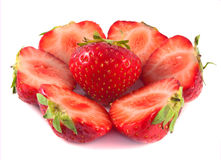 Sliced strawberries with leaves. . Sliced strawberries with leaves.  on white background Royalty Free Stock Photos