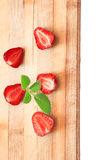 Sliced strawberries on a wooden board Royalty Free Stock Photo