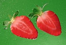 Sliced strawberrieson green stock photo