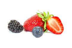 Sliced strawberry with bilberry isolated royalty free stock image