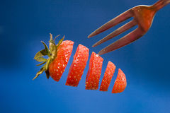 Sliced strawberry Stock Images