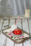 Sliced strawberry in a glass bowl on a vintage clay Royalty Free Stock Photography