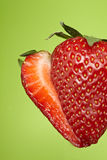 Sliced strawberry on green background Royalty Free Stock Photo