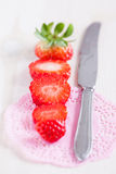 Sliced strawberry and knife Stock Photography