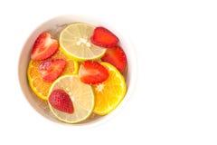 Sliced strawberry, orange, lemon on ice Stock Images