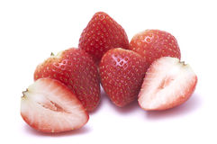 Sliced strawberry and piled strawberries without stalk Royalty Free Stock Photos