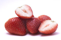 Sliced strawberry and piled strawberries without stalk. Close up shot of Sliced strawberry and piled strawberries on the isolated white background without stalk Royalty Free Stock Photos