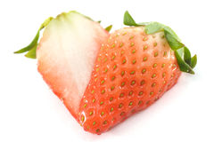 Sliced strawberry on white Stock Images