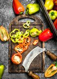 Sliced sweet peppers on an old cutting board. On a rustic background Royalty Free Stock Photo