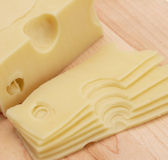 Sliced swiss cheese. Cheese sliced swiss fresh daily product gourmet Royalty Free Stock Images