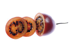 Sliced tamarillo fruit, close-up Royalty Free Stock Images