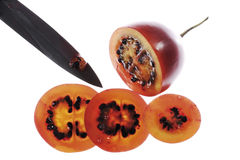Sliced tamarillo fruit, knife aside Stock Photos