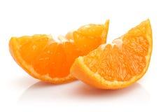 Sliced Tangerine. On white background royalty free stock images