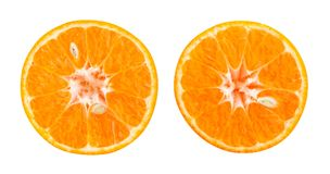 Tangerine. Sliced tangerine path isolated on white Royalty Free Stock Photo