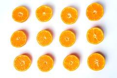 Sliced tangerine on white background flat lay Stock Photos