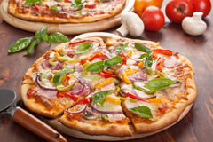 Sliced tasty pizza Stock Photos
