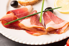 Sliced tasty spanish jamon and vegetables Stock Photography