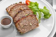 Sliced tasty turkey meatloaf on plates. Closeup stock image