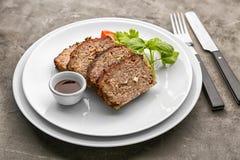 Sliced tasty turkey meatloaf served for dinner. On table stock photography