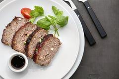 Sliced tasty turkey meatloaf served for dinner. On table royalty free stock image