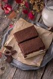 Sliced Tiramisu cake made of chocolate and white sponge. royalty free stock photography