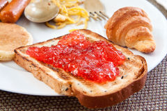 Sliced toast with red jam Stock Image