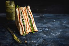 Served big toast sandwich. Sliced toast sandwich with ham on the wooden background with blank space,selective focus Royalty Free Stock Photos