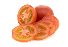 Sliced tomato. Sliced and whole tomatoes on white background Stock Image
