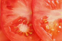 Sliced tomato background. Extreme colse up.Fullscreen Stock Photos