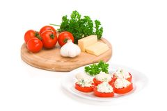 Sliced tomato with cheese sauce Royalty Free Stock Images