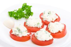 Sliced tomato with cheese sauce Royalty Free Stock Image