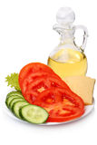 Sliced tomato, cucumber, cheese and sunflower oil Royalty Free Stock Images