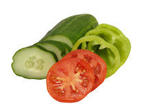 Sliced tomato, cucumber and green peppe.Isolated. Fresh sliced tomato, cucumber and green pepper on a white background Royalty Free Stock Images