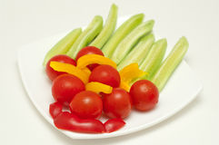 Sliced tomato, cucumber and peppers Stock Photos