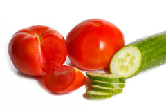 Sliced tomato and cucumber Stock Images