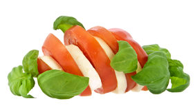 Sliced tomato, mozzarella and fresh basil Royalty Free Stock Photography