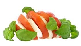 Sliced tomato, mozzarella and fresh basil Royalty Free Stock Photography