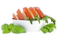 Sliced tomato / mozzarella and fresh basil Stock Photos
