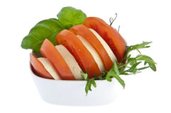 Sliced tomato / mozzarella and fresh basil Stock Images