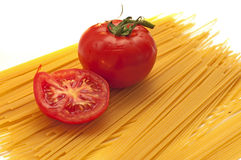 Sliced tomato and pasta royalty free stock photography