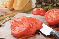 Sliced tomato and sandwich fixings Royalty Free Stock Images
