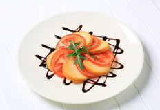 Sliced tomato and smoked cheese Royalty Free Stock Photos