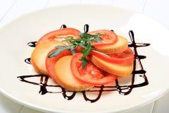 Sliced tomato and smoked cheese Stock Photos