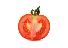 Sliced tomato with stem on white Royalty Free Stock Image