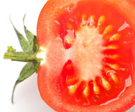 Sliced tomato with tail on white royalty free stock photography