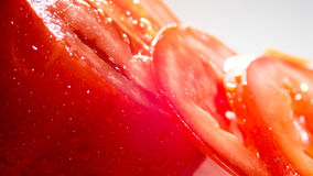 The sliced tomato on white background. The sliced tomato. Red tomato Stock Image