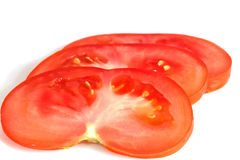 Sliced tomato on white. Extreme colse up.Isolated Royalty Free Stock Photography