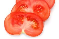 Sliced tomato on white. Extreme colse up.Isolated Royalty Free Stock Photo